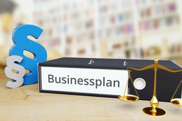 Businessplan – Gesetz/Recht. Ordner auf Schreibtisch mit Beschriftung neben Paragraf und Waage. Anwalt