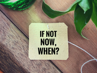 Inspirational wording - If Not Now, When written on a paper.