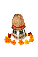 Picture of kalash and coconut with floral decoration for navratri pooja. Isolated on the white background.