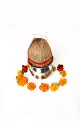 Photo of kalash and coconut with floral decoration for navratri pooja. Isolated on the white background.