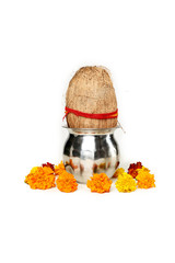 Portrait of kalash and coconut with floral decoration for navratri pooja. Isolated on the white background.