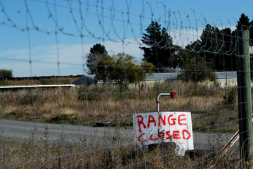A sign is seen at a closed shooting range outside Christchurch