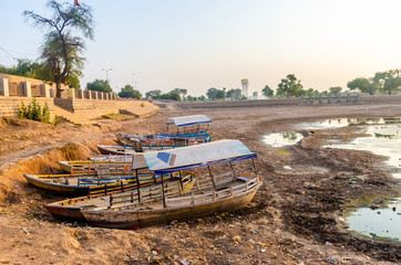 abandoned boats on the bank of dry muddy river