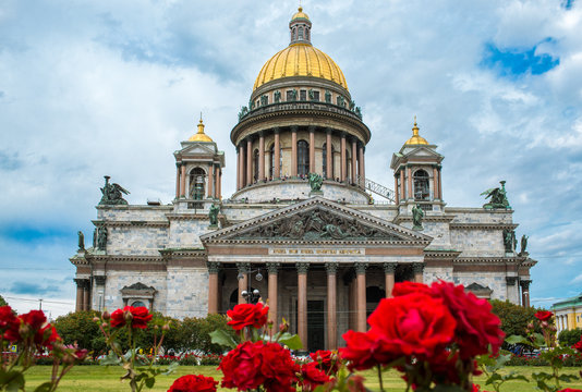 St isaacs cathedral in Saint-Petersburg, Russia, during springtime and red roses