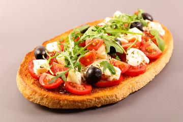 italian bruschetta with tomato, mozzarella, olive and basil