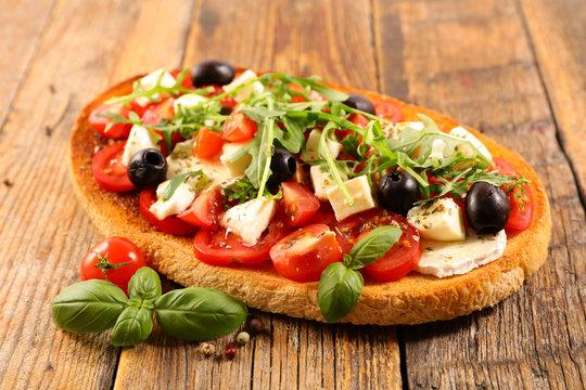 italian bruschetta with tomato, mozzarella, olive and basil