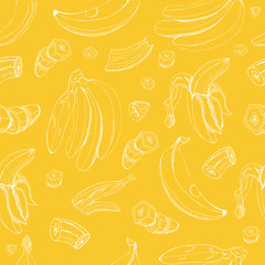 Seamless pattern  with inverted  white  bananas. Whole and sliced elemets isolated on yellow background. Hand drawn sketch.