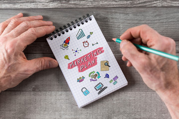 Marketing plan concept on a notepad