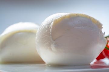 Balls of buffalo mozzarella, soft Italian scheese made from the milk of Italian Mediterranean buffalo