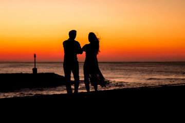 Couple dancing on the pier during sunrise make for awesome silhouettes