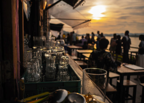 Empty glass At sunset, on the table with space for preparing for the party Along the Mekong River.soft focus.
