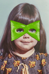Photo of child with a green superhero mask