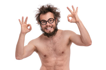 Crazy bearded Happy Man with funny Haircut in eye Glasses making Ok gesture.Cheerful and silly naked guy, isolated on white background.