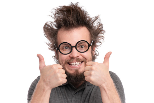 Crazy Bearded happy Man with funny Haircut in Eyeglasses making Thumbs up gesture. Cheerful and silly guy, isolated on white background.