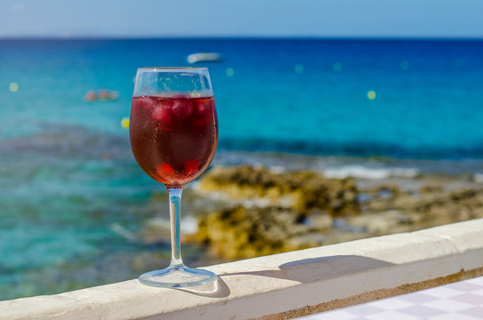 Glass of sangria by a sea bar