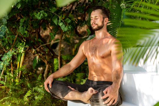guy doing yoga in the jungle