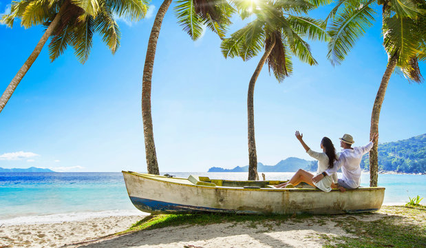 Happy Couple Relaxing on the Ocean. Seychelles island