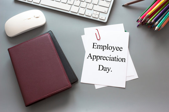 Text Employee appreciation day on white paper book and office supplies on wood desk / business concept