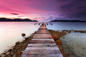 Sunset over the wooden jetty in marina island, perak Wall mural
