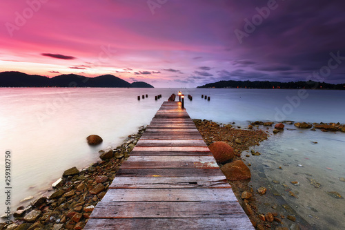 Wall mural Sunset over the wooden jetty in marina island, perak
