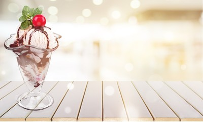 Ice cream with chocolate sauce on white background