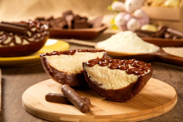 Gourmet easter egg, stuffed with cream and chocolate. Easter egg with pudding cream, Easter dessert. Easter concept.