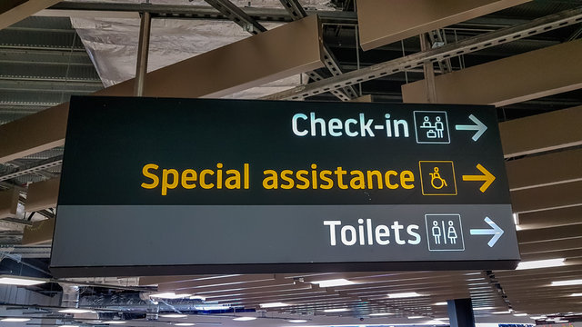 Airport signage for check in and special assistance at Luton Airport