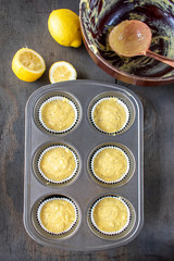 muffin tin cupcakes of lemon poppy seed cake mix with ingredients in flat lay