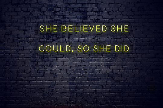Positive inspiring quote on neon sign against brick wall she believed she could so she did