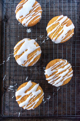 baked lemon poppy seed cupcakes with white icing drizzle flat lay