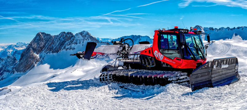 Snow Mobile on top of the rock with blue sky Background in high resolution