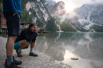 Woman taking picture with camera outdoors