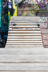 Wooden lounge chair with colorful graffiti wall