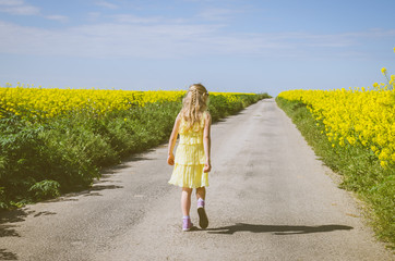 little child walking in rural path in beautiful summer nature