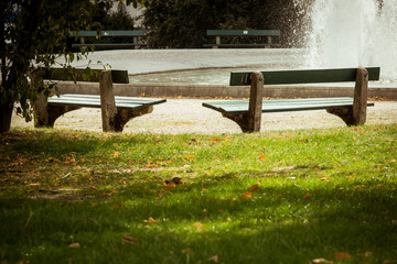 Benches in park next to big fountain