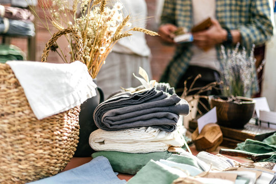 Textile, homemade goods, wicker basket on the summer outdoor vintage and fashion designer market
