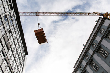 Construction container in the air between buildings in the city