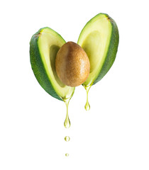 Drops of oil dripping from avocado, isolated on white background
