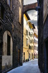 Wall Mural - Street with arch in the historic Old Town of Florence, Tuscany, Italy