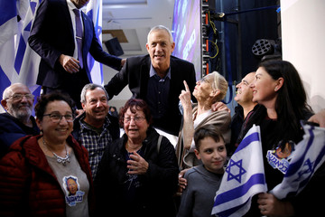 Benny Gantz, leader of Blue and White party, poses for a picture with his supporters during an election campaign event in Ashkelon, Israel