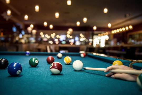 Selective focus at billiard ball on blue table