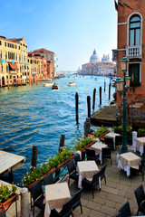 Wall Mural - Beautiful view of the famous Grand Canal with cafe and Basilica Santa Maria della Salute, Venice Italy