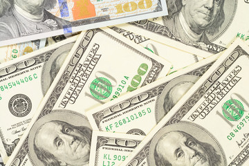 One hundred dollars banknotes background. High resolution photo of money macro.