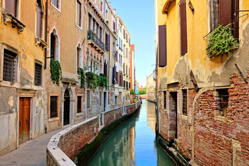 Fototapete - Picturesque narrow canal in the beautiful city of Venice, Italy