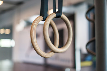 Wooden turn rings in fitness hall