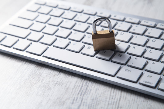 Padlock with computer keyboard. Internet and computer security