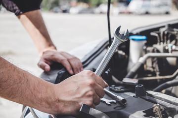 Fotobehang Zeilen Services car engine machine concept, Automobile mechanic repairman hands repairing a car engine automotive workshop with a wrench, car service and maintenance