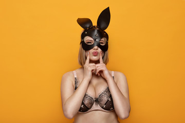 Sexy blonde girl with leather bunny ears