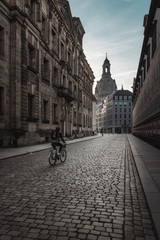 Man riding bike in old town, Dresden, Germany