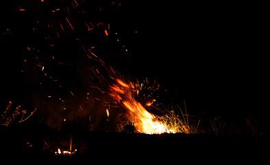 Fond de hotte en verre imprimé Volcan Burning fire at night outdoor in nature.